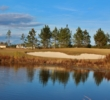 Water guards the seventh green at the Golf Club at Hilton Head Lakes in Hardeeville, South Carolina.