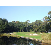 The par-4 second hole on Palmetto Dunes Resort's Oceanfront Course plays over water before the green.