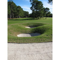 Landing in one of series of pot bunkers behind Harbour Town Golf Links's ninth green could lead to another sand shot from the front side.
