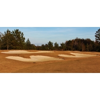 Bunkers ring the 10th green of the Golf Club at Hilton Head Lakes in Hardeeville, S.C.
