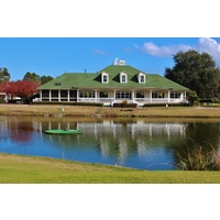 The Old South Golf Links clubhouse sits next to a pond.