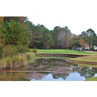A pond guards the par-3 eighth green at Eagle's Pointe Golf Club in Bluffton.