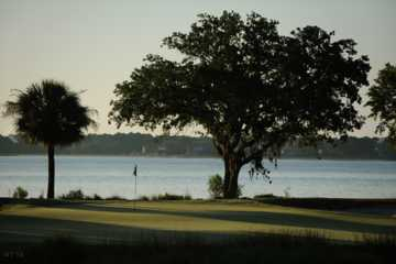 A view of a green with water in background at Haig Point Club